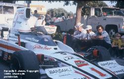 Long Beach  Brian Redman w/back to camera, Jim Hall & Franz Weis.