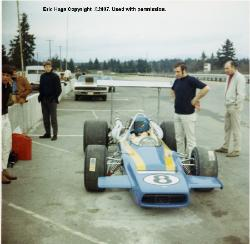 Crew chief, Larry Webb standing next to Eric Haga's T-190 early testing session